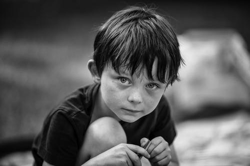 Grayscale Photo of Boy in Black Shirt