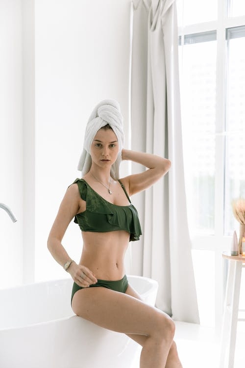 Photo Of Woman Sitting On Tub