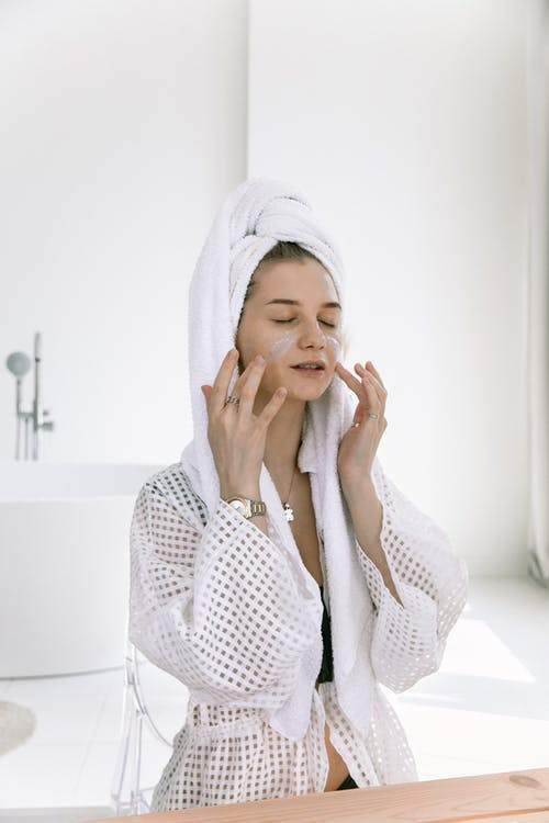 Photo Of Woman Applying Cosmetics On Her Face