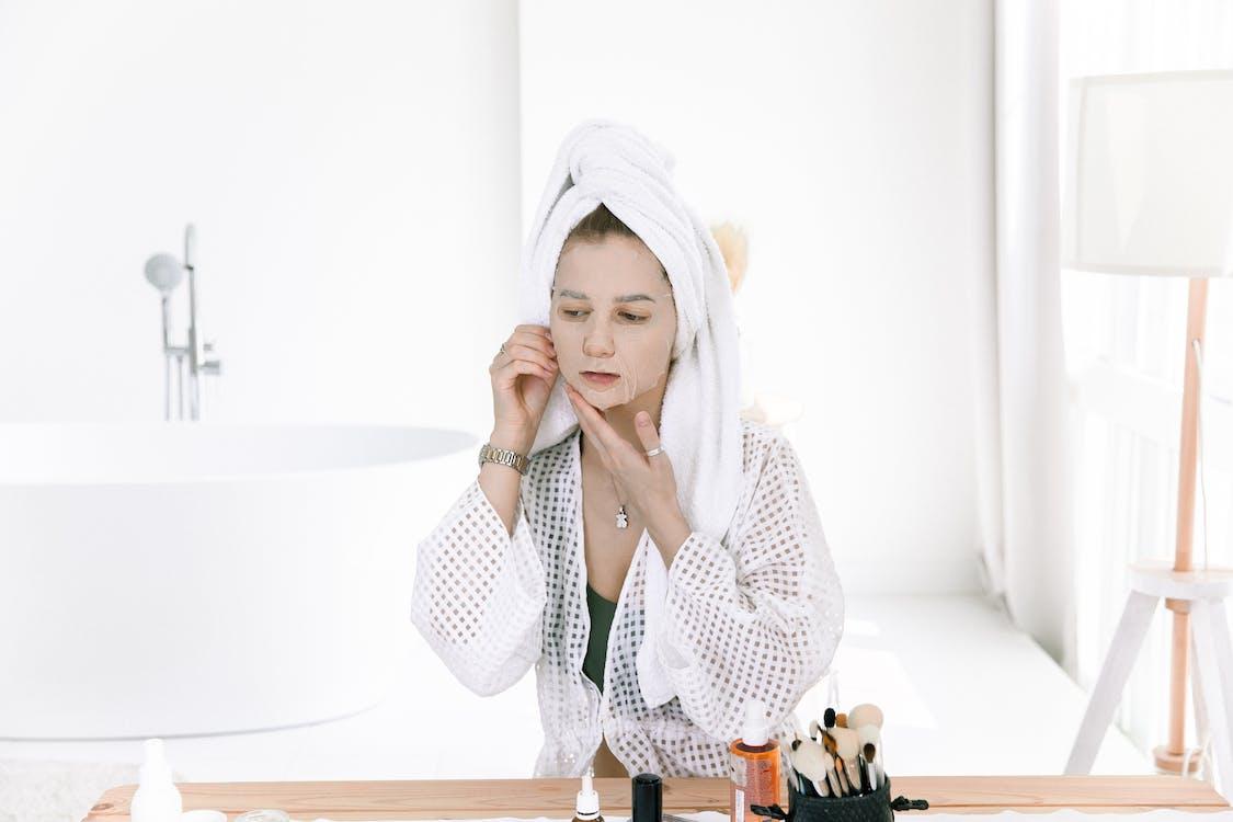 Photo Of Woman Applying Facial Mask