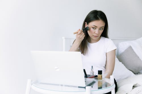 Photo Of Woman Looking On Laptop