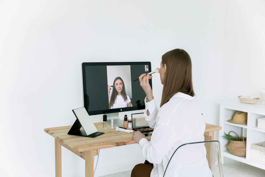 Photo Of Woman Looking On Desktop