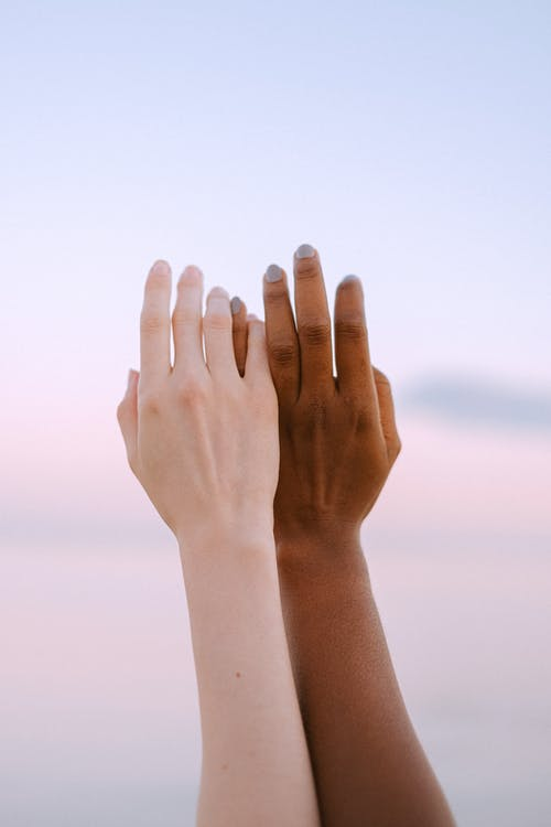 Close-Up Photo Of People Hands