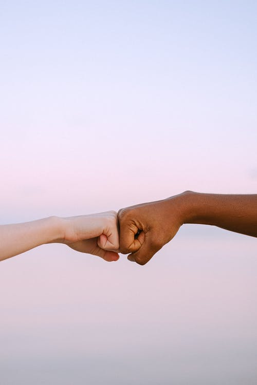 People Doing a Fist Bump