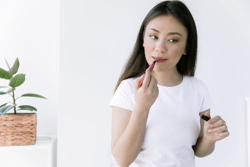 Photo Of Woman Applying Liptint On Her Lips