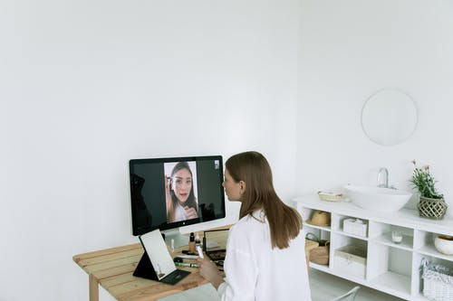 Photo Of Woman Looking On The Screen