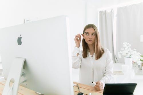 Photo Of Woman Putting Eyebrow Mascara