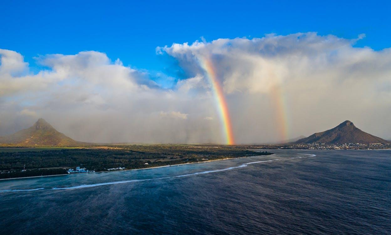 Photo Of Rainbow Under Cloudy Sky