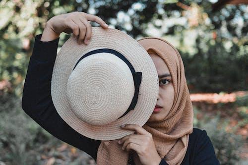 Photo Of Woman Holding Fedora Hat