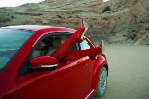 Red Ferrari 458 Italia on Brown Sand