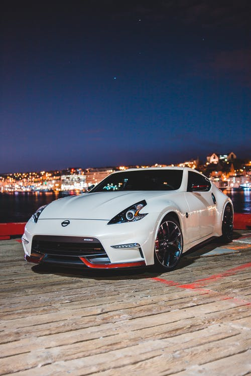 Photo Of Sports Car During Evening