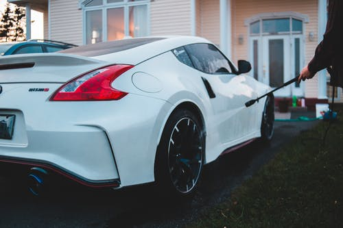 Close-Up Photo Of White Sports Car