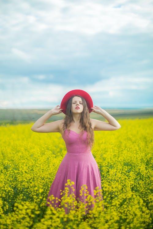 Photo Of Woman Wearing Pink Dress