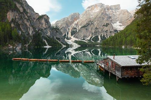 Brown Wooden Dock on Lake Near Mountain