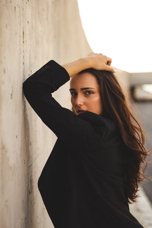 Photo Of Woman Leaning On Wall