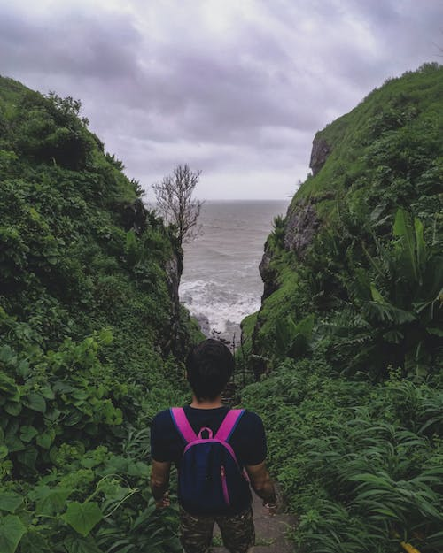 Free stock photo of backpacker, beach, cliff, india