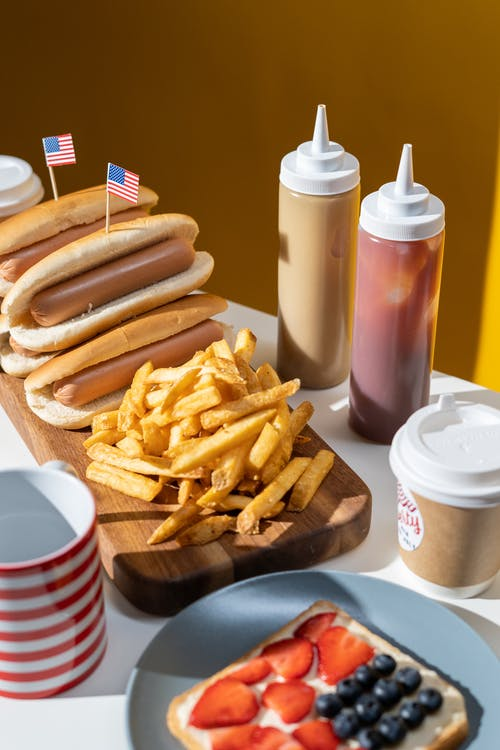 French Fries and Hotdogs Served on Table