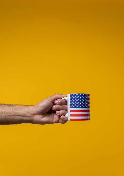 Person Holding a Mug with the American Flag
