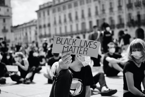 Grayscale Photo of People Protesting In The Street