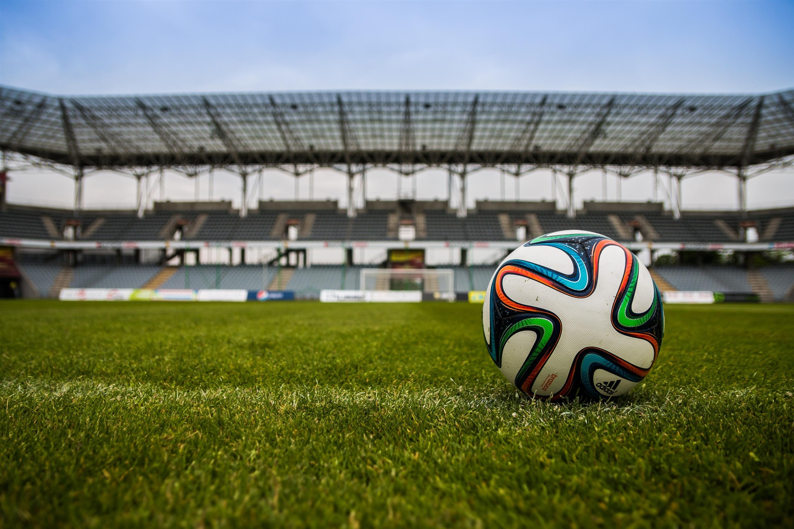 Soccer Ball on Grass Field during Daytime
