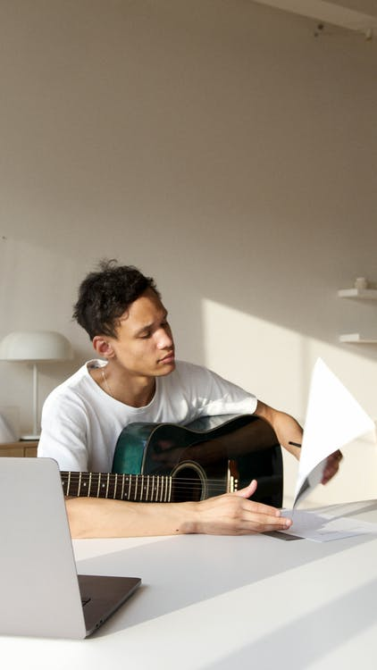 Man in White Crew Neck T-shirt Playing Acoustic Guitar