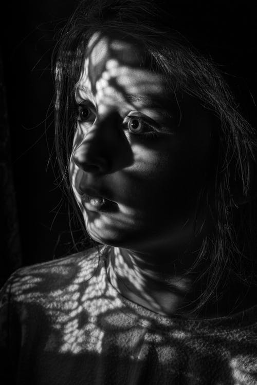 Young girl with shadow on face