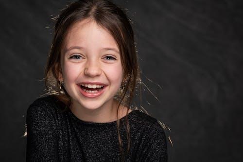 Girl in Black Top Smiling