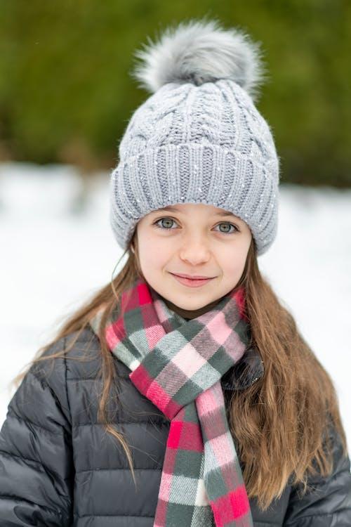 Girl Wearing Gray Knit Cap Smiling