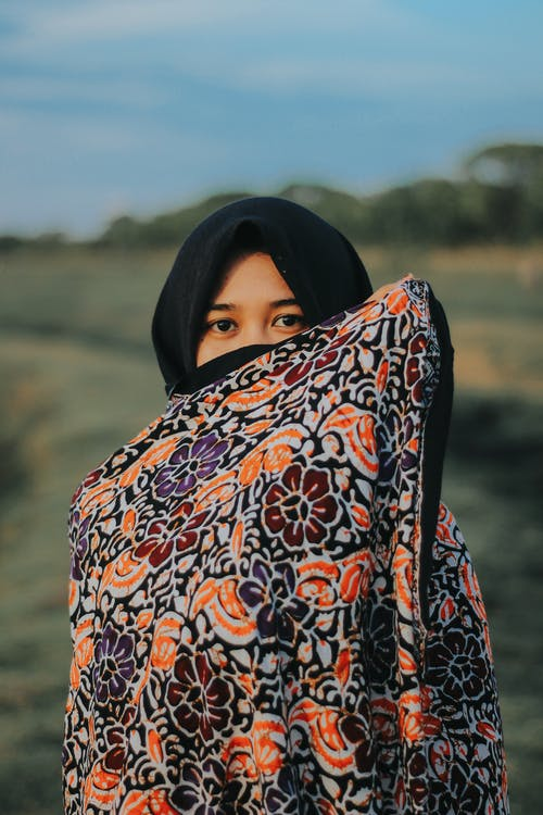 Woman in Black White and Orange Hijab