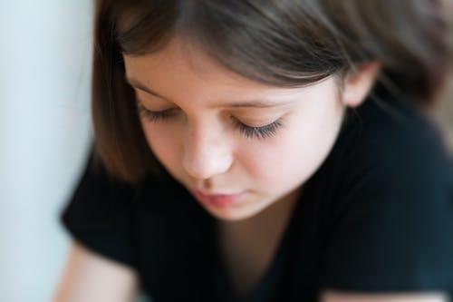 Selective Focus Photo of Girl's Face