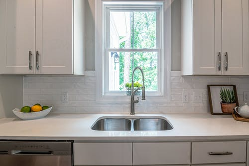 Photo of Faucet and Sink Near White Wooden Framed Glass Window