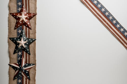 Army stars on piece of fabric near American flag
