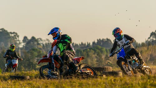 Men Riding Motocross Dirt Bikes