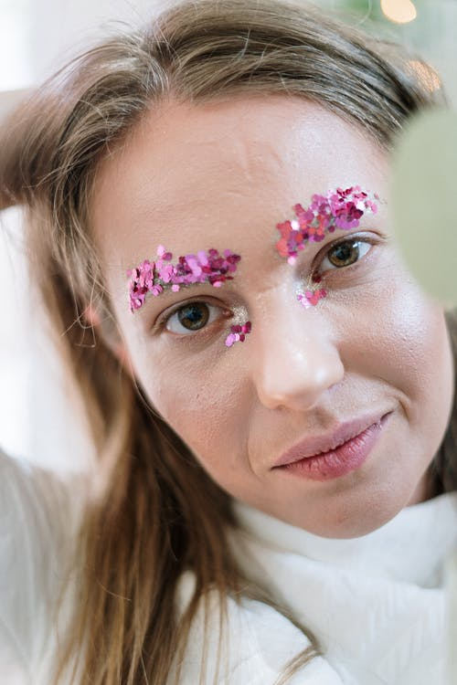 Woman With Pink and White Flower on Her Face