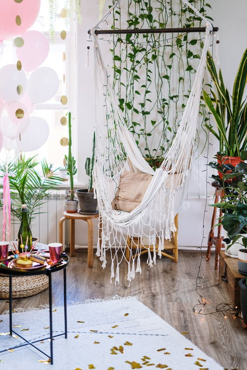 White Hammock Hanged on Green Plant