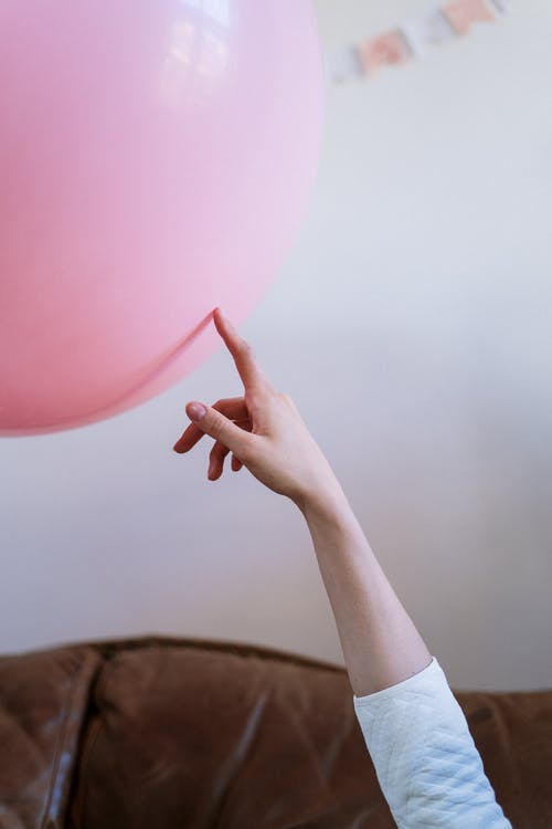 Person Holding Pink Balloon