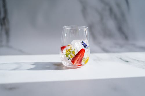 Clear Drinking Glass With Red and White Liquid