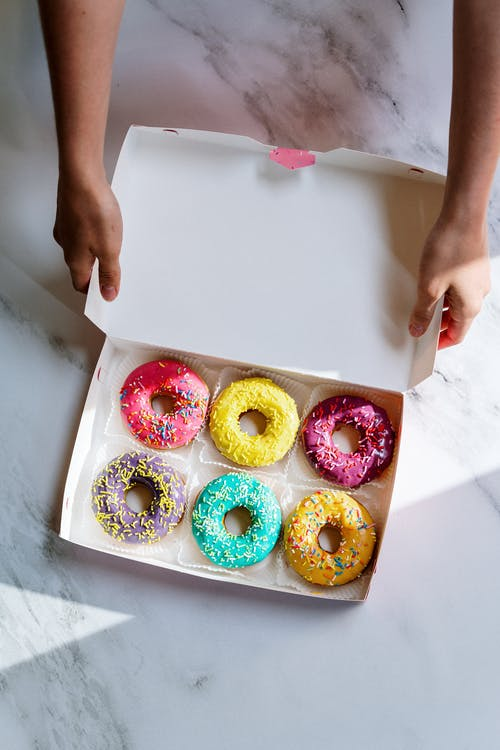 Person Holding White Tray With Doughnuts