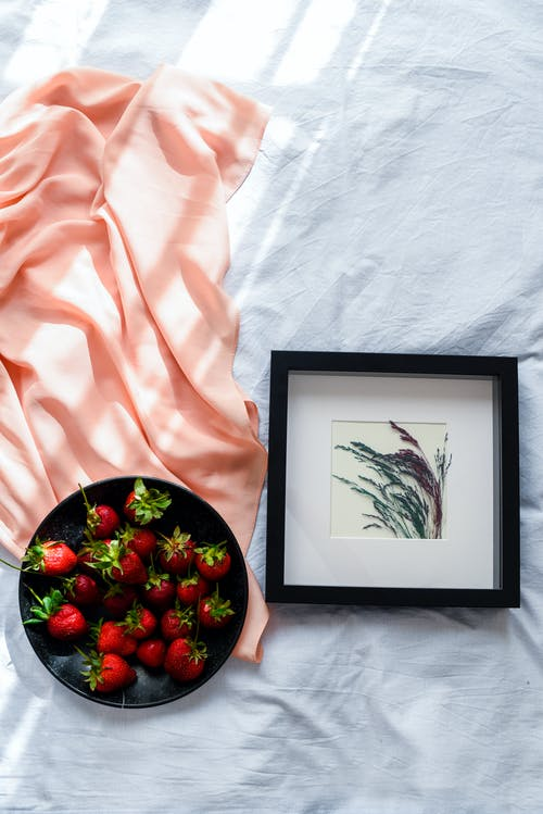 Black Wooden Framed Red Strawberries on White Textile