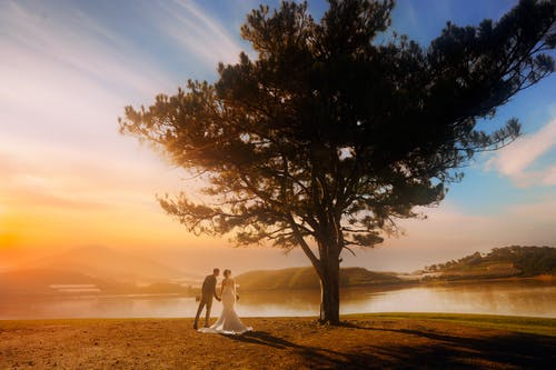 Married couple near calm water