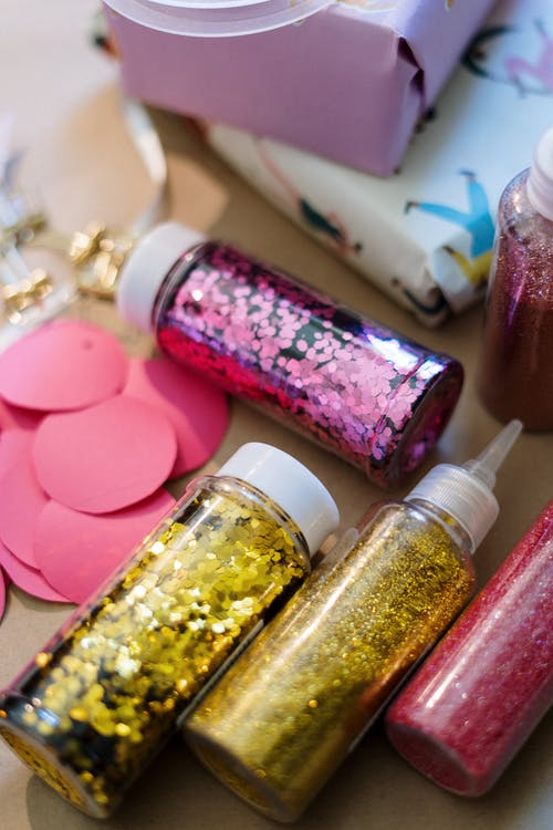 Pink and Yellow Nail Polish Bottles