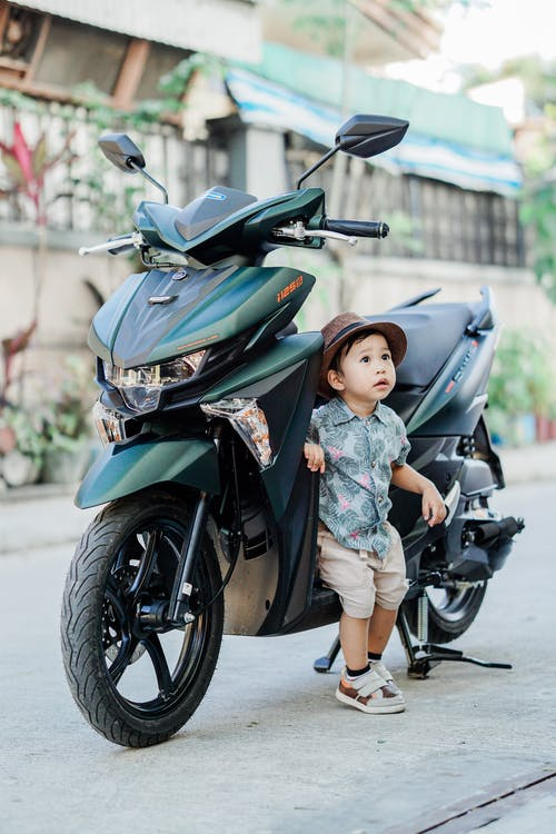 Boy Sitting on a Motorcycle