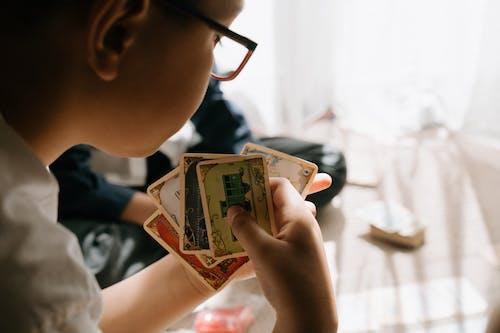 Boy in Black Framed Eyeglasses Holding 10 Us Dollar Bill