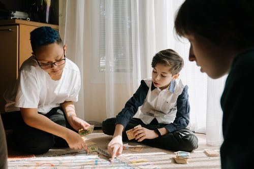 2 Boys Playing on the Table