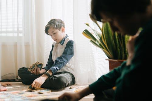 Boy in Gray Suit Jacket Sitting on Floor