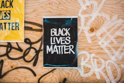 Sign Black Lives Matter on sheet on wall