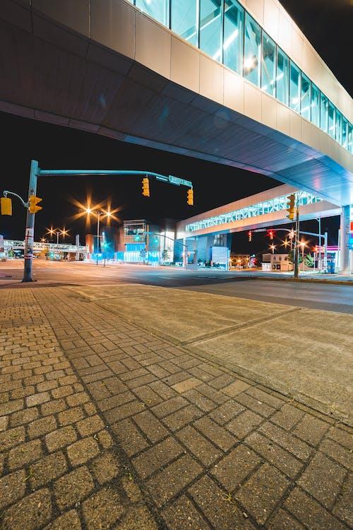 Pedestrian bridge over asphalt road and pavement