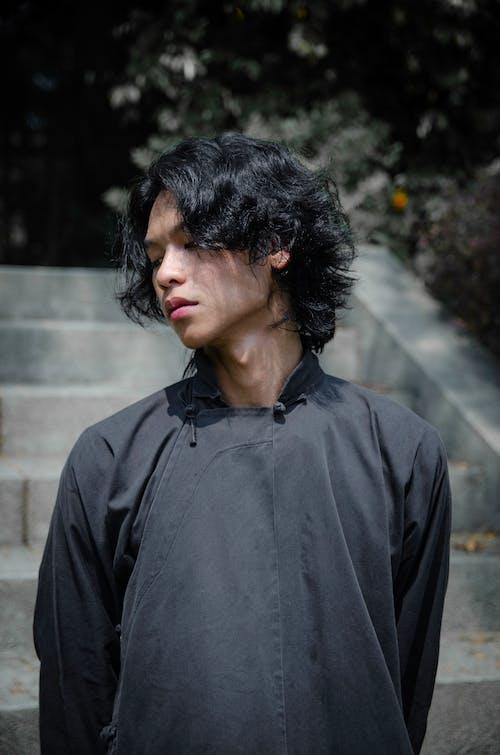 Man Wearing Black Traditional Clothing