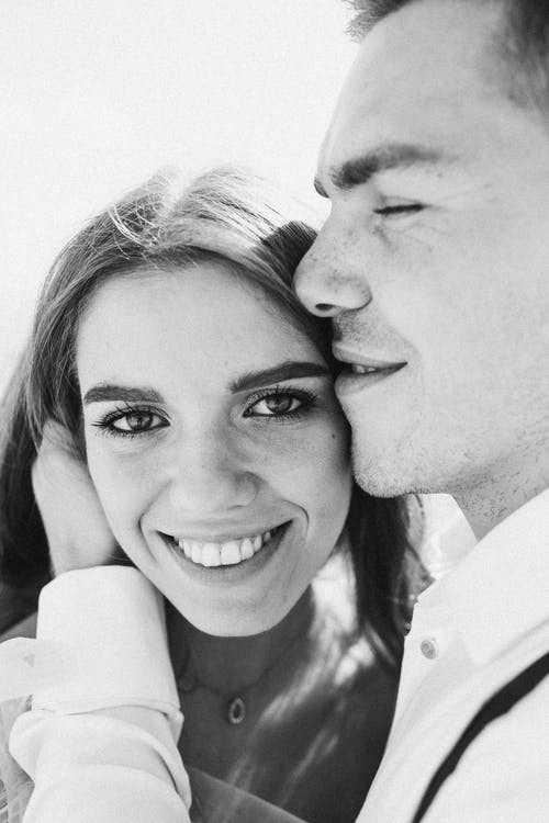 Close-Up Photo of Couple Smiling