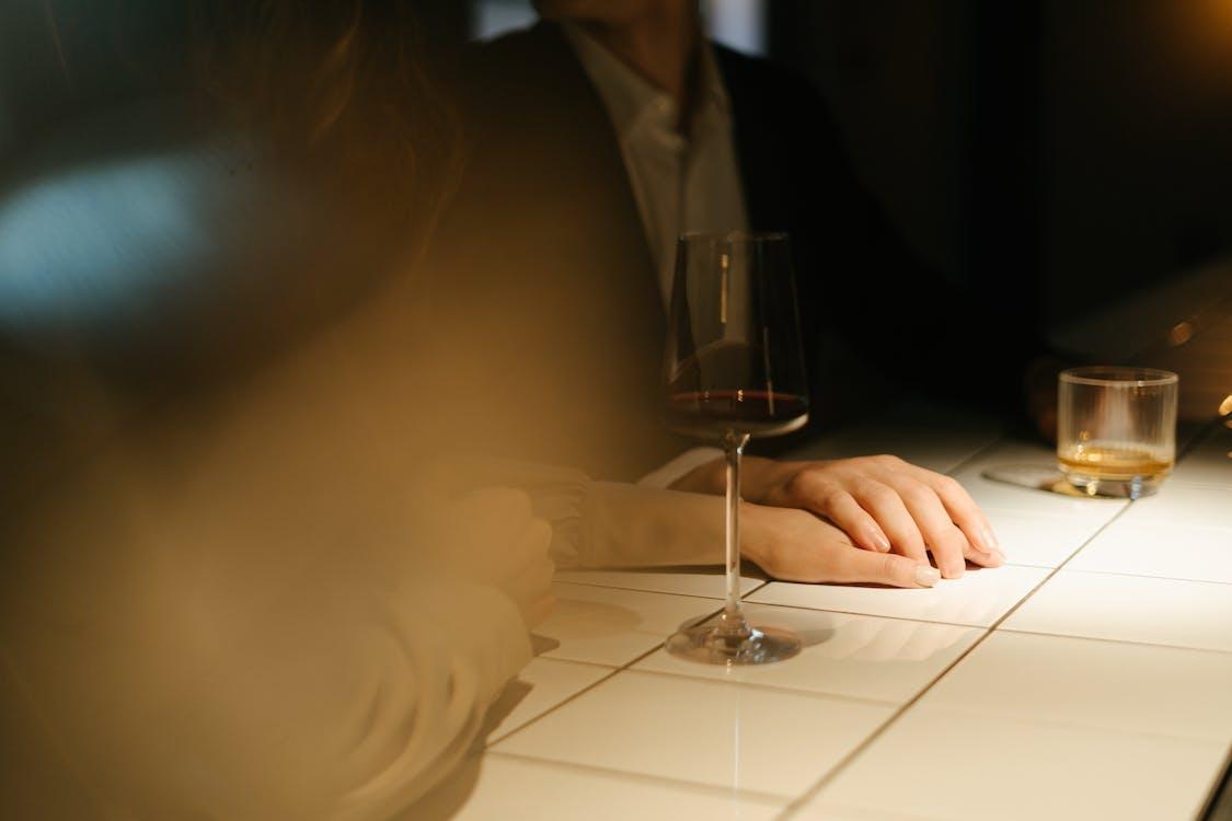 Woman in Black Blazer Holding Clear Wine Glass